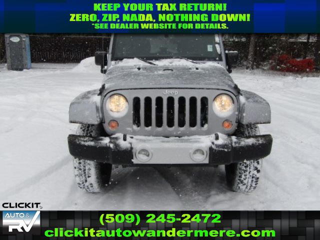Pre-Owned 2014 Jeep Wrangler Unlimited Sahara 3.6L V6 4x4 Manual SUV